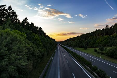 Empty highway at sunset