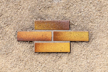 Ornament of bricks on concrete layer.Vintage wall background and texture. Standard-Bild
