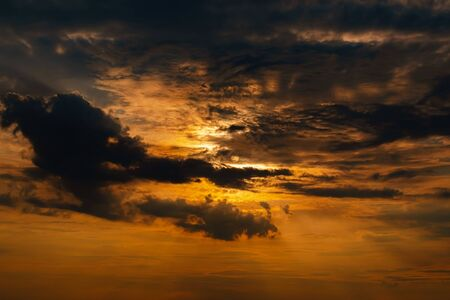 Orange sunset sky with clouds Stock Photo