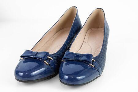 Dark blue women's shoes on white background.