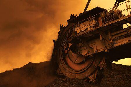 Giant Bucket Wheel Excavator in Coal Mine at Sunset