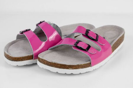 Female pink household slippers on white background