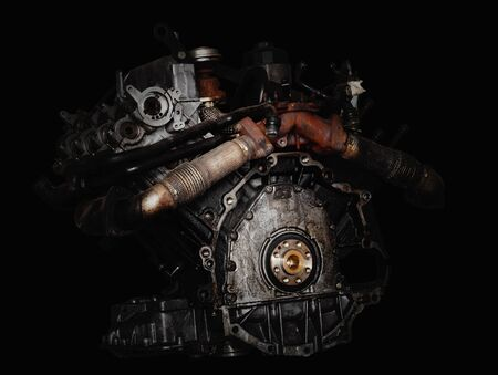 Car engine on black background