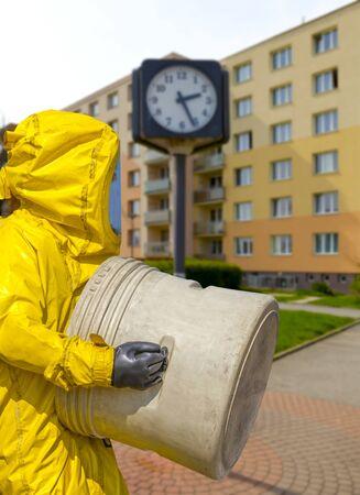 Man wearing yellow protective hazmat suit Stock Photo