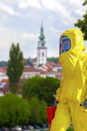 Man wearing yellow protective hazmat suit. Epidemic virus.