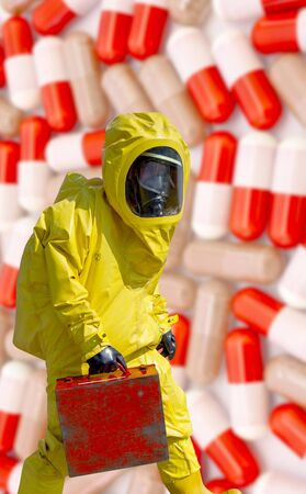 Man in yellow protective hazmat suit with pills