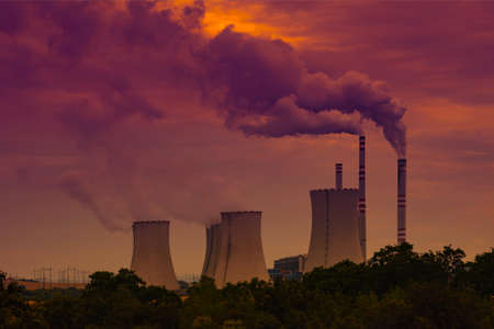 Coal power plant at sunset sky
