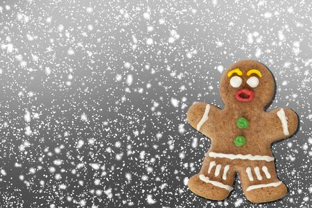 Gingerbread man on christmas background