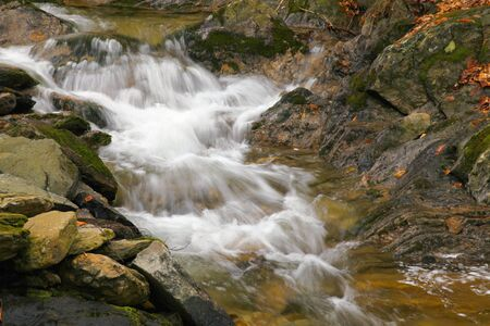 Waterfall on mountain stream in the National park Sumava-Czech Republic. Autumn landscape.