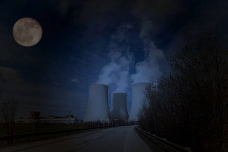 Nuclear power plant Temelin with night sky with moon, Czech Republic.