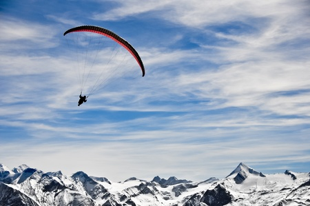 Parachutist in the Alps mountains