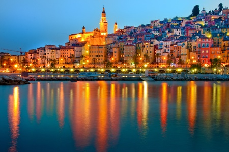 Menton Provence village at night with water reflection