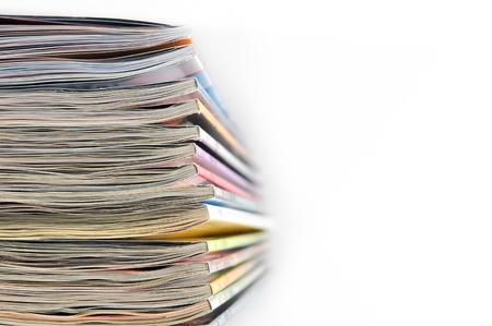 Stack of magazines on whiteckgrond photo
