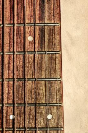 guitarra acustica: Diapas�n de la guitarra ac�stica del cuello en la textura de fondo