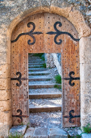concrete steps: Old open wooden door with stairs Stock Photo