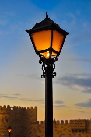 Street lamp on blue dusk sky background photo