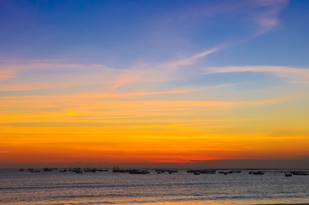 Ocean coast colorful sunset and fishing boats, Bali photo