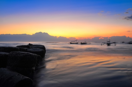Ocean coast sunrise and fishing boats, Bali