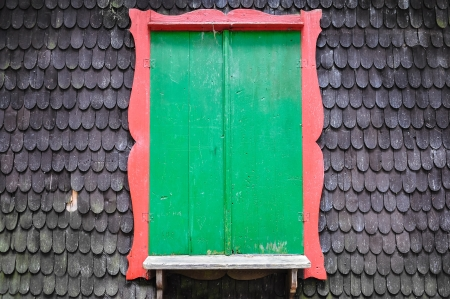Green window on wooden textrued wall photo