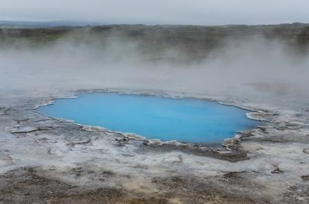 crater highlands: Detail of blue geothermal pond in Hveravellir, Iceland