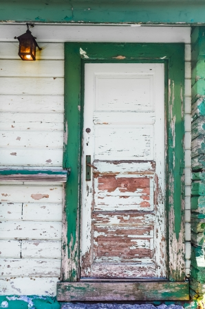 Rusty old green textured wooden door Stock Photo - 15253985