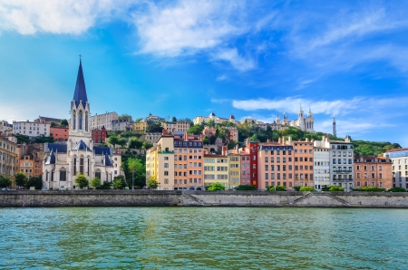 lyon: Lyon cityscape from Saone river with colorful houses and river