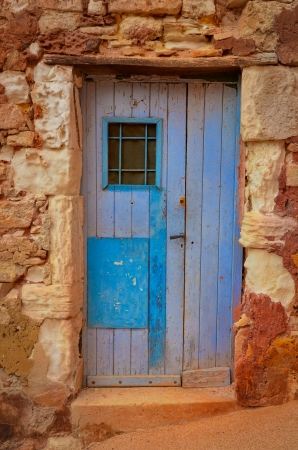 Old textured door in a stone wall photo