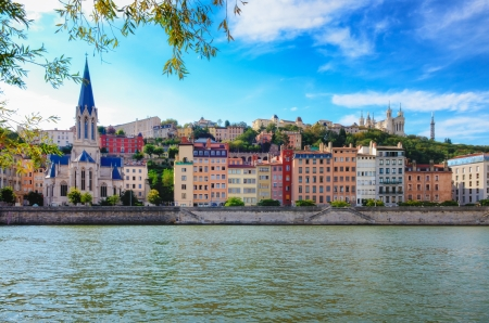 riverside landscape: Lyon cityscape from Saone river with colorful houses and river  Stock Photo