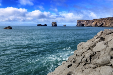 Dyrholeay cliffs and rocks ocean view, Iceland photo