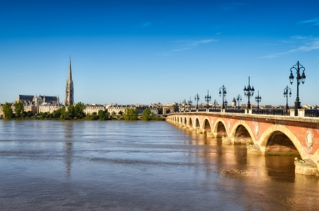 famous industries: Bordeaux river bridge with St Michel cathedral, Bordeaux, France