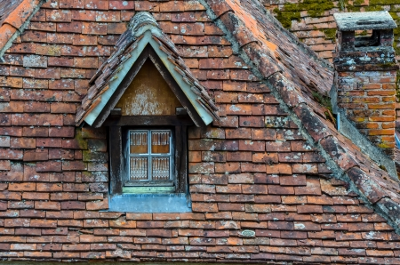windows frame: Old brick roof with window and a chimney vintage retro