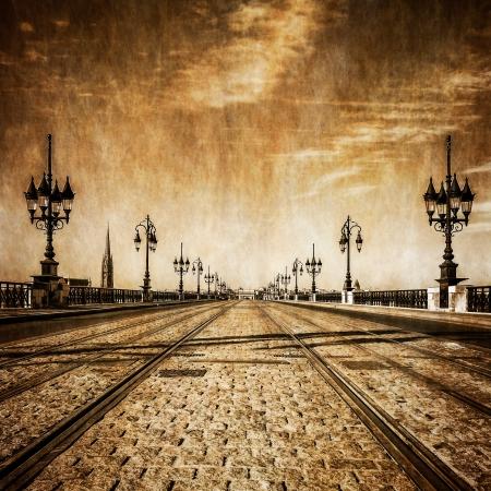 Bordeaux river bridge with railway tracks, vintage retro view, France photo