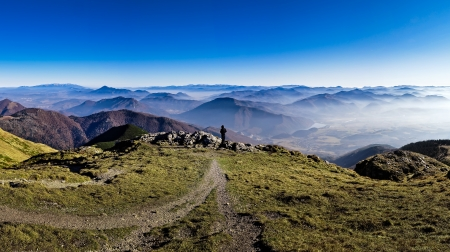 Silhouette of a man overlooking misty mountains landscape in Mala Fatra, Slovakia photo