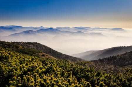 Misty mountains with blue sky, landscape view in Mala Fatra, Slovakia
