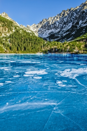 Mountain ice lake with cracked textured ice, High Tatras, Slovakia Stock Photo - 17458901