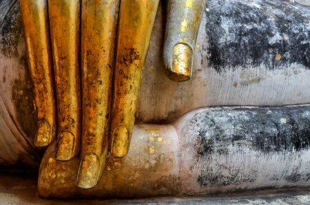 chum: Beautiful golden hand of sitting Buddha in Wat Si Chum temple in Sukhothai, Thailand