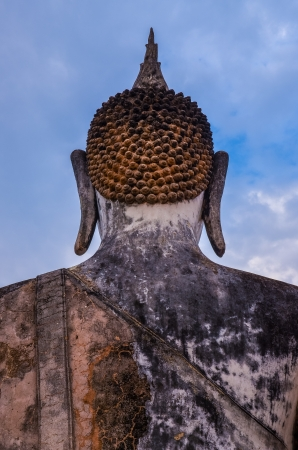 Detail of head of stone statue of sitting Buddha in Sukhothai historical park, Thailand photo