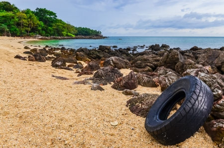 polution: Washed out tyre at beautiful ocean coast in Andaman sea, Thailand