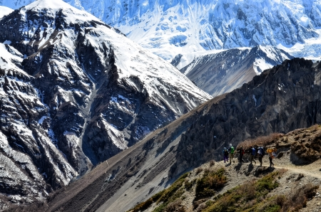 sherpa: Group of mountain trekkers backpacking in Himalayas mountains, Nepal Stock Photo