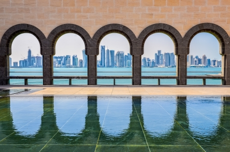 Doha skyline seen through the arches at the Museum of Islamic art, Doha, Qatar