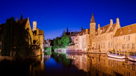 brugge: River canal and medieval houses at night, Bruges, Belgium