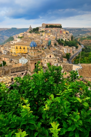 Beautiful village Ragusa with green tree in foreground, Sicily, Italy