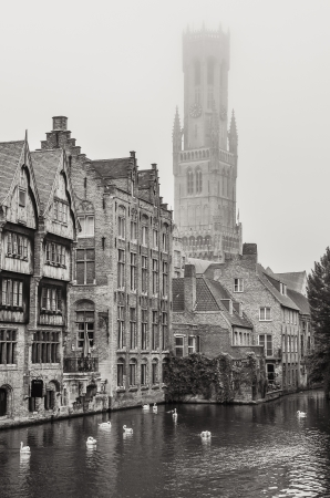 brugge: Bruges water canal and Belfry tower in monochrome vintage, Belgium