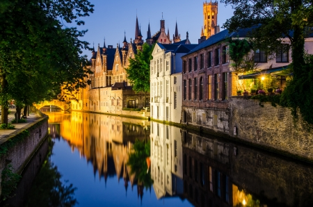 brugge: Water canal, medieval houses and bell tower at night, Bruges Stock Photo