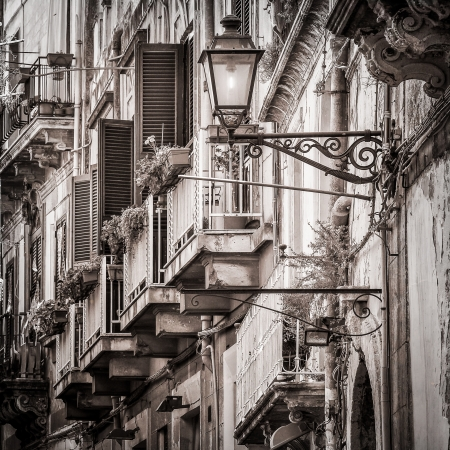 Beautiful vintage balcony and street lamp in mediterranean street photo