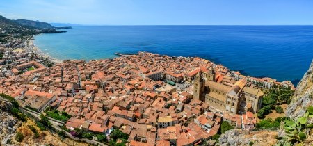 Panoramic view of village Cefalu and ocean, Sicily, Italy photo
