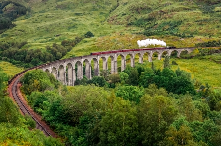 steam train: Steam train on a famous Glenfinnan viaduct, Scotland, Great Britain Stock Photo