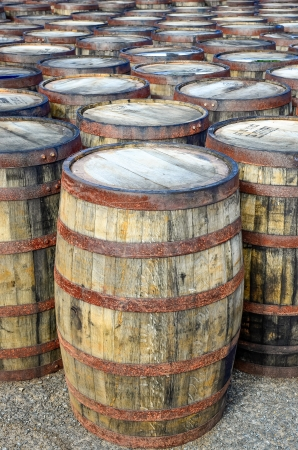 casks: Horizontal detail of stacked whisky casks and barrels Stock Photo