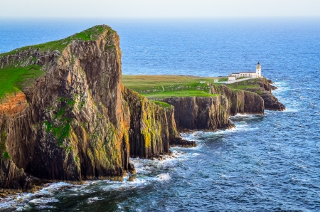 scottish: View of Neist Point lighthouse and rocky ocean coastline, highlands of Scotland