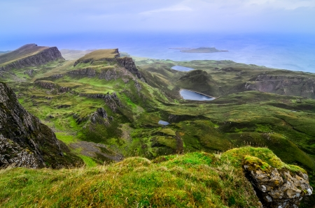 Scenic view of green Quiraing coastline in Scottish highlands, United Kingdom photo